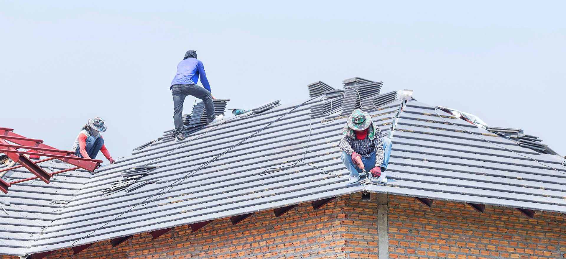 person repairing thr roofs