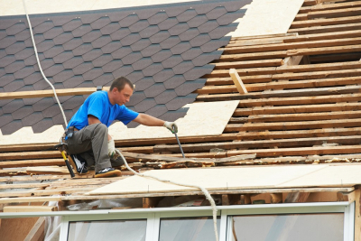 man installing a roof