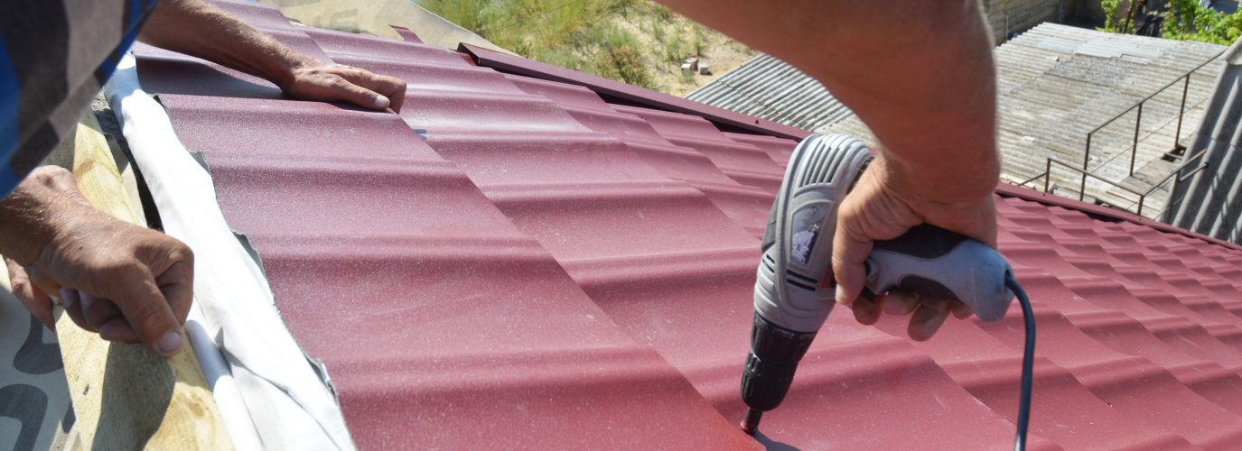 fixing a roof with a drill